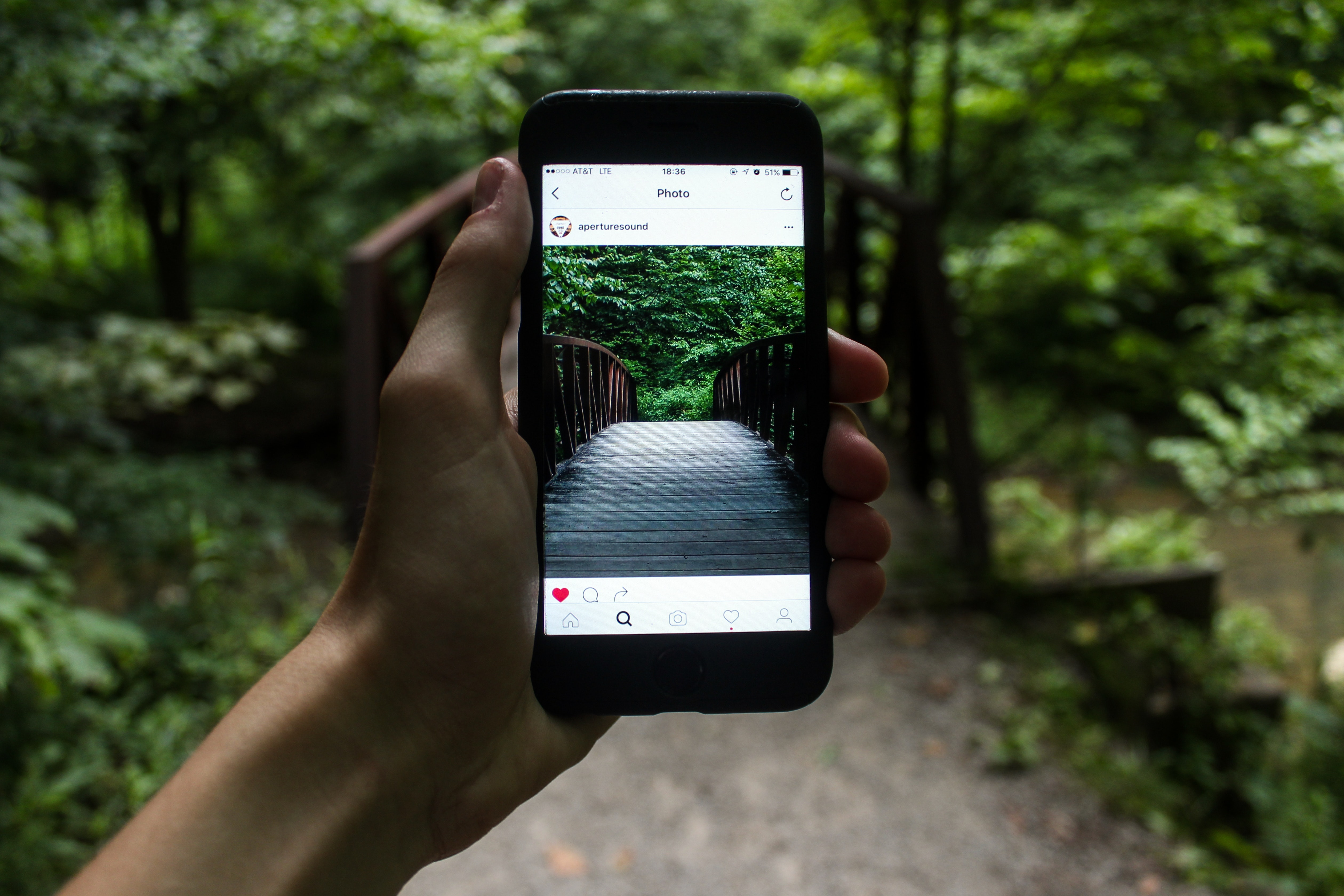 person-holding-smartphone-taking-picture-of-bridge-during-122383